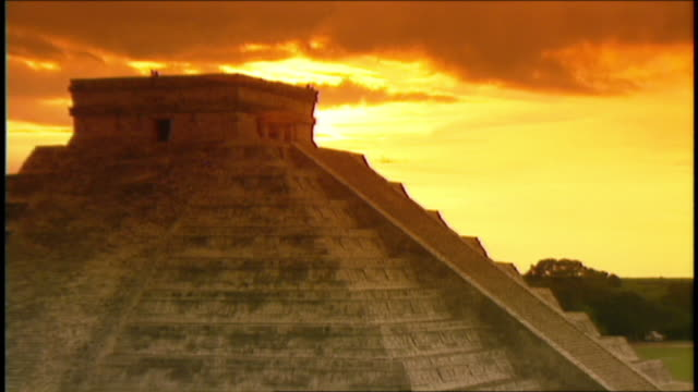 Clouds fill the sky above a South American pyramid.
