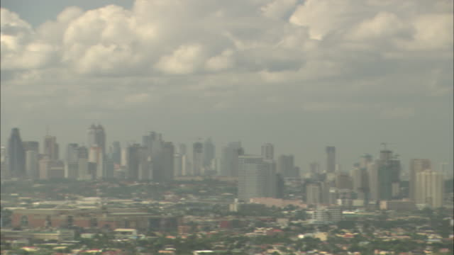 Clouds fill the sky above the Manila cityscape.