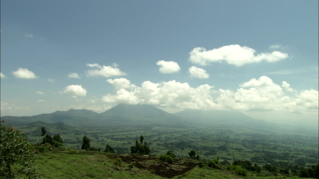 clouds float above the volcanoes in the parc national des volcans. - parc national stock videos & royalty-free footage