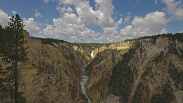 Clouds float over Lower Yellowstone Falls and the Yellowstone River in Grand Canyon of the Yellowstone, Yellowstone National Park, Wyoming.