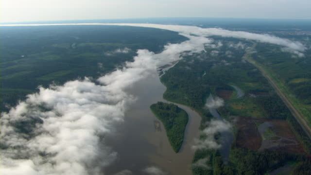 Clouds float over the Athabasca River near Fort McMurray, Alberta, Canada.