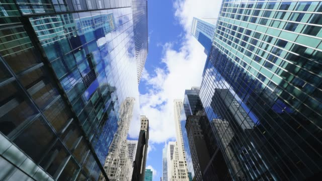 clouds float over the rows of 42nd street high-rise office buildings at midtown manhattan ny usa on oct. 24 2018. - tower stock videos & royalty-free footage
