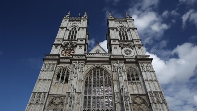 stockvideo's en b-roll-footage met clouds float over the towers on westminster abbey in london, england. - westminster abbey