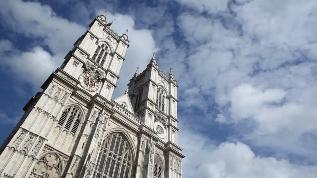 Clouds float past Westminster Abbey in Westminster, England.
