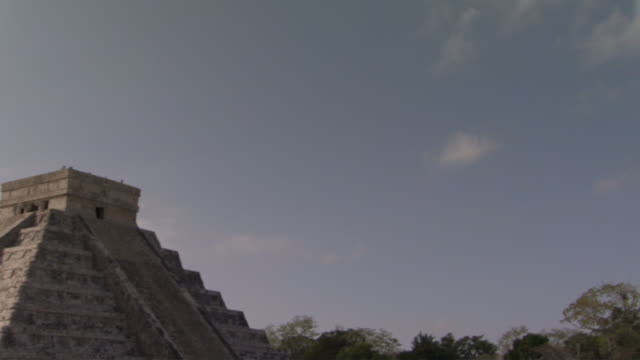 ws pan td clouds floating above kukulkan pyramid at ancient mayan site chichen itza / yucatan, mexico  - chichen itza stock videos and b-roll footage