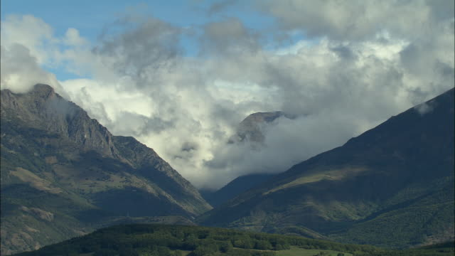 aerial ws clouds floating above mountain peaks in maritime alpes / rhone-alpes, france - rhone alpes stock videos & royalty-free footage
