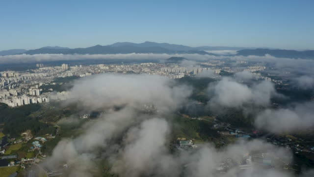 clouds floating above the city / chuncheon-si, gangwon-do, south korea - atmosphere filter stock-videos und b-roll-filmmaterial