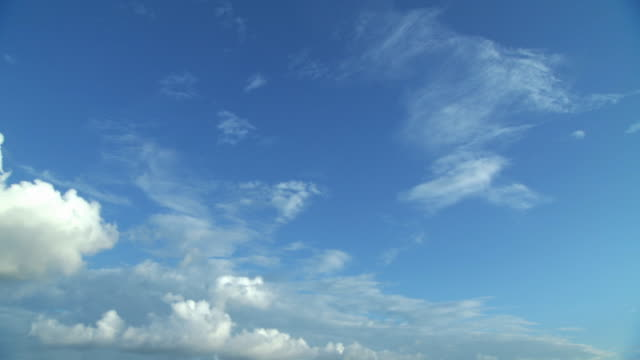 LA WS Clouds floating in bright blue sky / Montego Bay, Jamaica