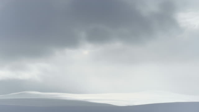 Clouds floating over the snowy landscape of the Hardangervidda in Norway