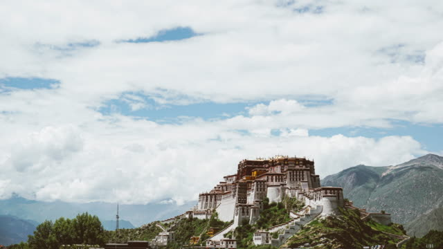 clouds flow in the sky at the potala palace in tibet - temple building stock videos & royalty-free footage