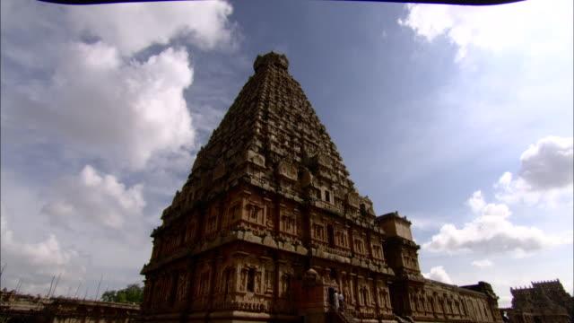 clouds fly over brihadeeswarar temple - temple building stock videos & royalty-free footage