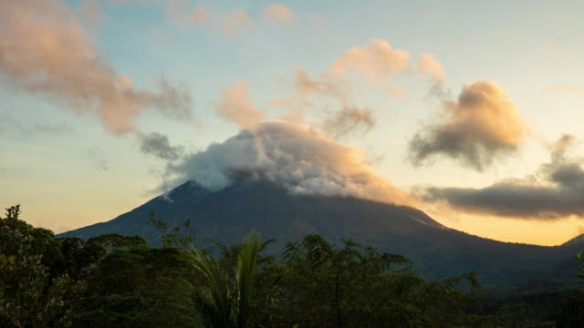 t/l 8k clouds forming over arenal volcano at sunset - costa rica video stock e b–roll