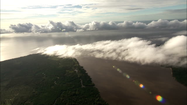 Clouds hang above the Amazon River delta. Available in HD.