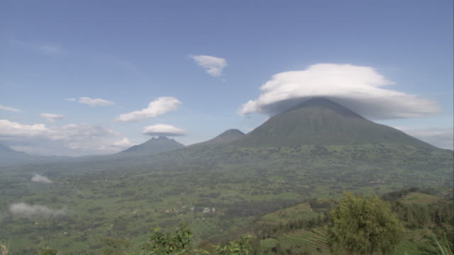 Clouds hang low over volcanoes in the Virunga Mountains. Available in HD.