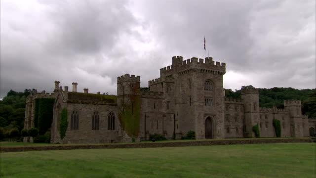 clouds hang over hampton court castle in herefordshire. available in hd. - herefordshire bildbanksvideor och videomaterial från bakom kulisserna
