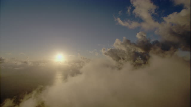 clouds hang over the coral sea at golden hour. available in hd. - golden hour stock videos & royalty-free footage