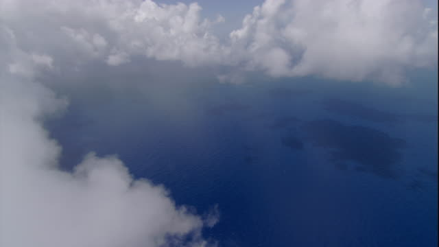 clouds hang over the pacific ocean near australia. available in hd. - stilla havet bildbanksvideor och videomaterial från bakom kulisserna