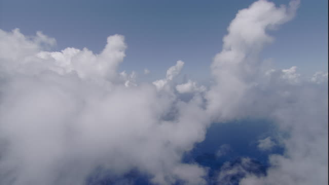 Clouds hang over the Pacific Ocean near Australia. Available in HD.