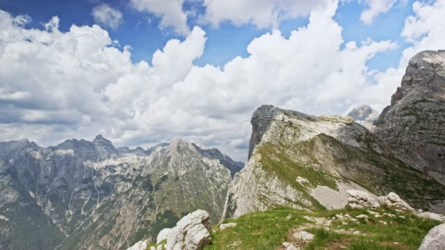 time-lapse clouds high in the mountains on a sunny day - slovenia stock videos & royalty-free footage