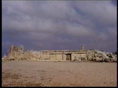 clouds hover above the hagar qim temple complex. - obelisk stock videos & royalty-free footage