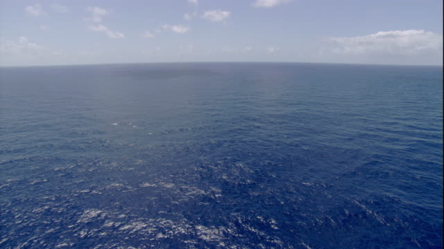 clouds hover over the pacific ocean near australia. available in hd. - bbc stock videos and b-roll footage