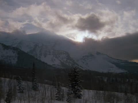 clouds hover over the peaks of mt. el dorado, utah. - utah stock videos & royalty-free footage