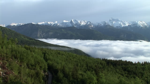 WS, PAN, Clouds hovering above valley, Debeli Vrh, Triglav National Park, Gorenjska region, Slovenia