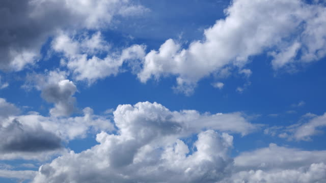 4k: clouds in blue sky, time lapse - moving past stock videos & royalty-free footage