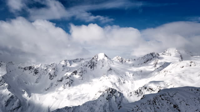 Clouds in the snowy alps time lapse