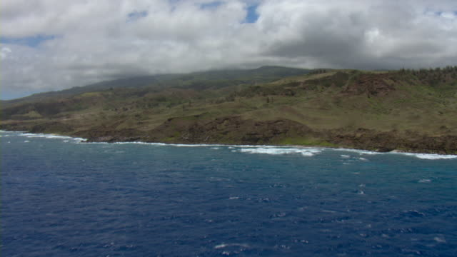Clouds loom over the island of Maui in the Pacific Ocean.