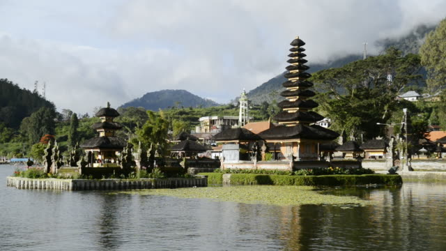 ws clouds low down over temple in lake / lake bratan, indonesia - pura ulu danau temple stock videos & royalty-free footage