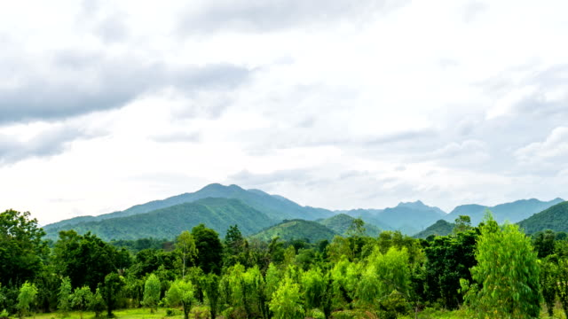 clouds motion passing over green tropical mountain - high dynamic range imaging stock videos and b-roll footage