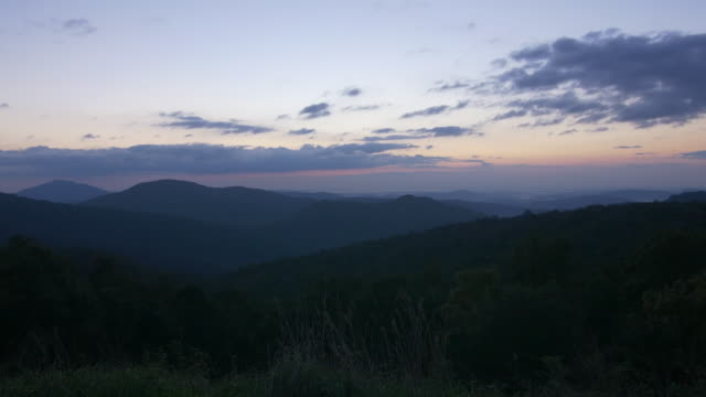 clouds, mountain, grass and wind at twilight - hill stock videos & royalty-free footage