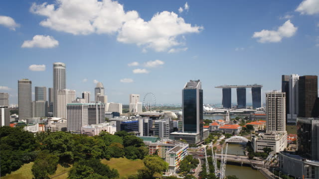 clouds move over fort canning park and the modern city skyline of singapore. - canning stock videos & royalty-free footage