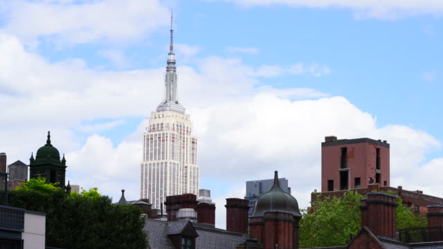 Clouds move over the Manhattan behind the Empire State Buildings at New York City. Image captured from High Line Park.
