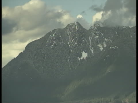 clouds move slowly over a mountain peak - environment or natural disaster or climate change or earthquake or hurricane or extreme weather or oil spill or volcano or tornado or flooding stock videos & royalty-free footage