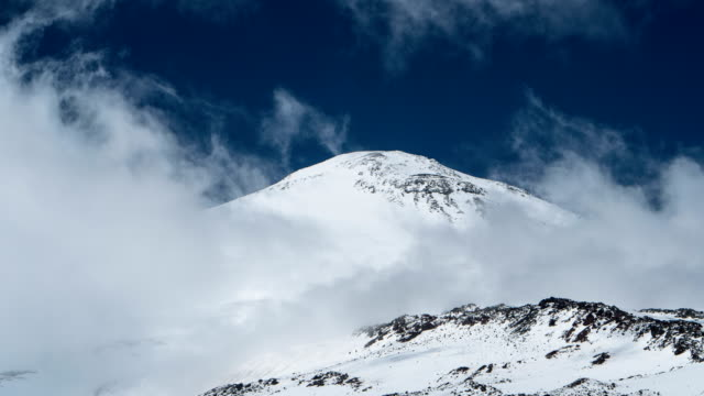 clouds moving above elbrus. timelapse - mountain stock videos & royalty-free footage