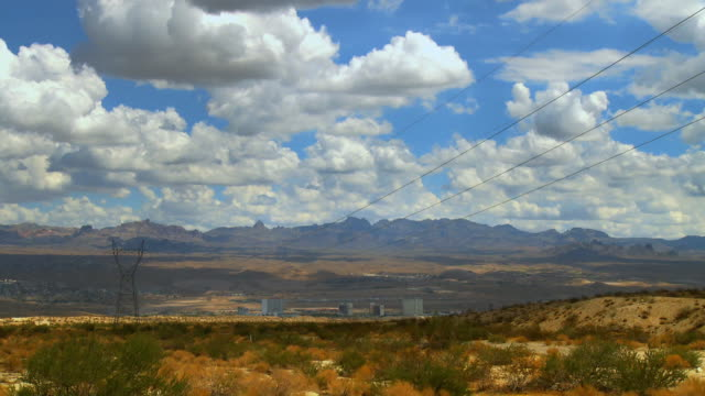 T/L, WS, Clouds moving above Laughlin and surrounding desert, Nevada, USA