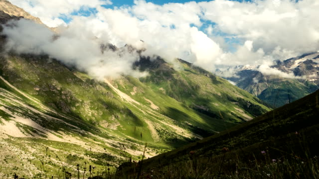 clouds moving above mountain valley. caucasus mountains timelapse - mountain pass stock videos & royalty-free footage