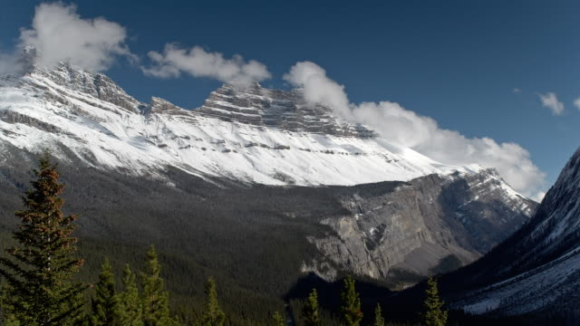 T/L WS Clouds moving above Rocky Mountains and canyon near Icefields Parkway in Jasper National Park / Alberta, Canada