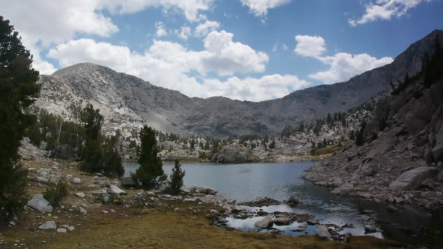 tl clouds moving above wilderness mountains and pristine lake, kings canyon national park, sierra nevada mountains, california - canyon lake stock videos & royalty-free footage