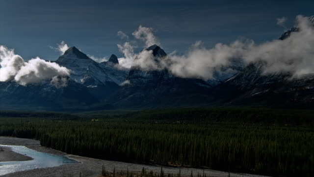 T/L WS PAN Clouds moving across Mount Fryatt and Athabasca River in Jasper National Park / Alberta, Canada
