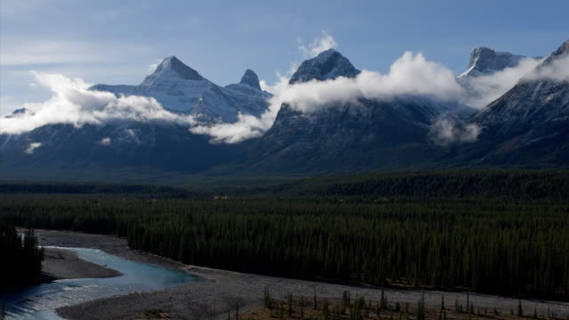 stockvideo's en b-roll-footage met t/l ws clouds moving across mount fryatt near athabasca river in jasper national park / alberta, canada - jasper national park