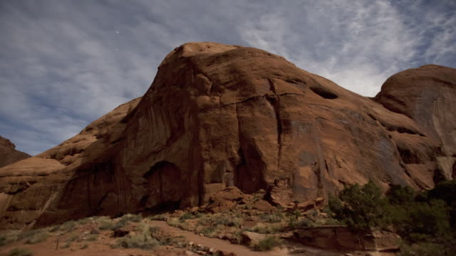 ws clouds moving across star studded sky leaving shadows on rock formations and desert landscape / page, neveda, united state - rock formation stock videos & royalty-free footage