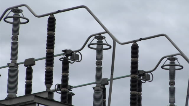 vidéos et rushes de cu clouds moving behind electrical transformers / new york, new york, usa - autre thème