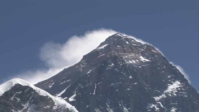 ms clouds moving behind  mount everest summit / gorak shep, khumbu region, nepal - khumbu stock videos and b-roll footage
