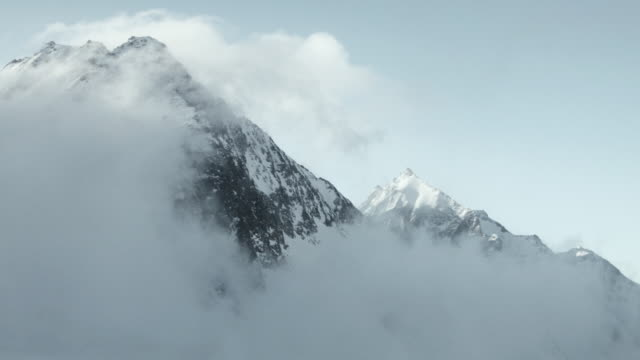 Clouds moving in over mountain range in Swiss Alps