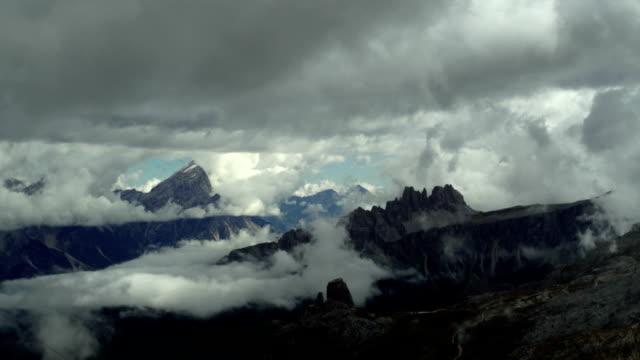 clouds moving over dolomites mountains pan tl - stratocumulus stock videos and b-roll footage