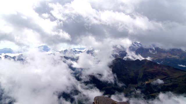 clouds moving over dolomites mountains pan - traditionally austrian stock videos and b-roll footage
