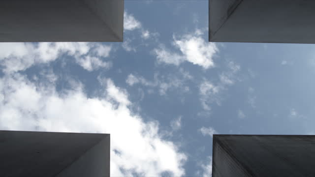 clouds moving over holocaust memorial (memorial to the murdered jews of europe) / berlin, germany - corner stock videos & royalty-free footage